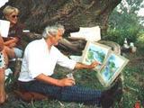 Der Künstler hilft beim Malen